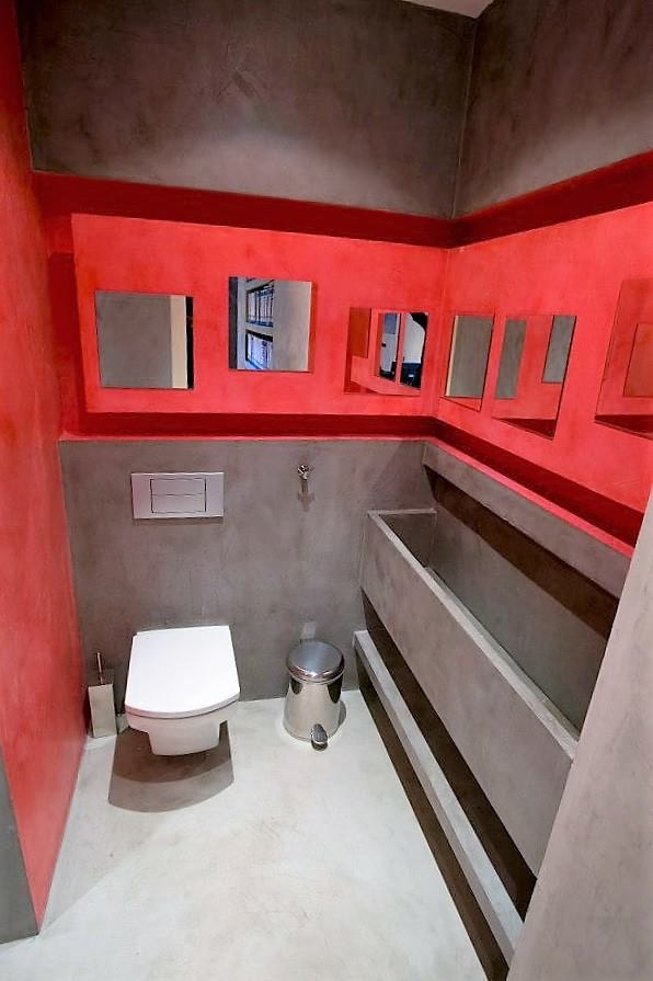 red and grey coloured microcement bathroom