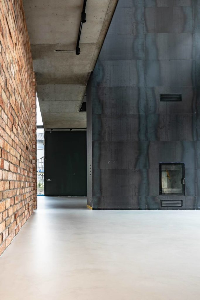 Mirocement floor in a modern barn house