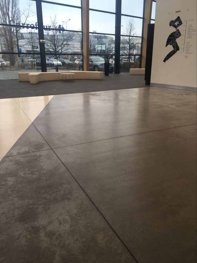 Polished concrete floor with visible signs of wear. If polyurethane varnish was used for concrete, the floor would be less damaged.